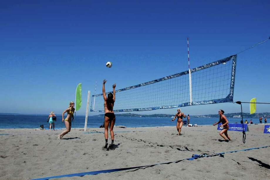 From left: Shauna Metschke, Naomi Fowler, Gena Aytch and Kamila Nowak play in a volleyball tournament at Alki Beach in Seattle on Saturday, July 30, 2011. Saturday's temperatures climbed into the high 70s around the region, and although there's a chance of rain Sunday, once that passes forecasters say we're at the start of at least a week of days just like Saturday. It's not much, but we'll take it. Photo: JOE DYER / SEATTLEPI.COM