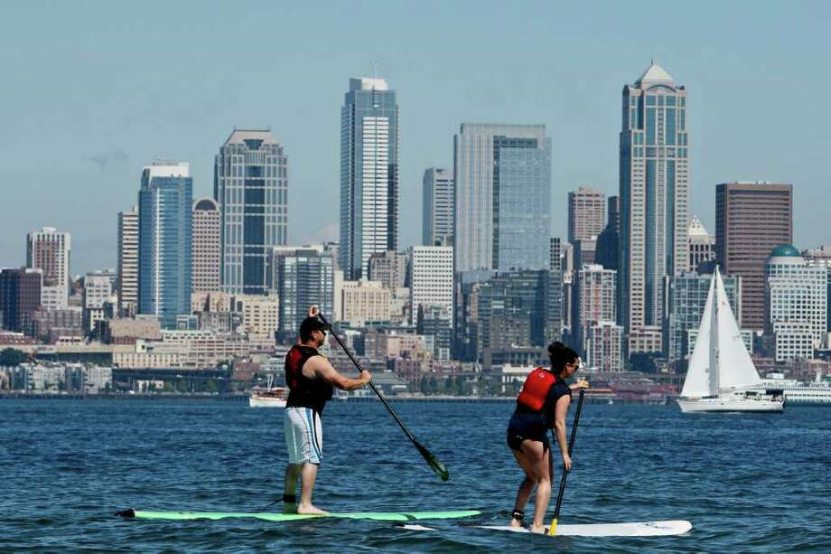 Paddle boarding along Alki Beach in Seattle. Photo: JOE DYER / SEATTLEPI.COM