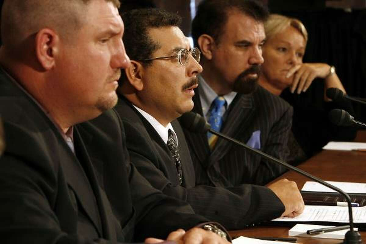Former KBR/Halliburton employees Sean Larvenz, left, Edward Sanchez and Julie McBride, right, and McBride's lawyer Alan Grayson, testify before the Senate Democratic Policy Committee during a hearing about contracting abuses in Iraq on Monday on Capitol Hill in Washington, DC.