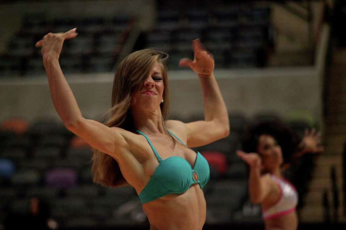 Katherine Hendrix dances for the judges during the Spurs Silver Dancers auditions at the AT&T Center on Saturday, July 30, 2011.