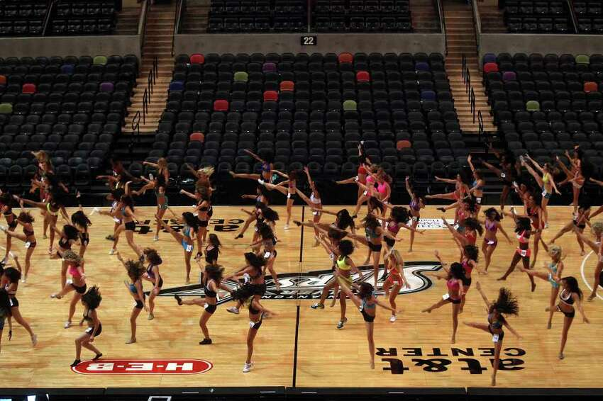 Spurs Silver Dancers hopefuls learn the first routine they will compete with during auditions at the AT&T Center on Saturday, July 30, 2011.