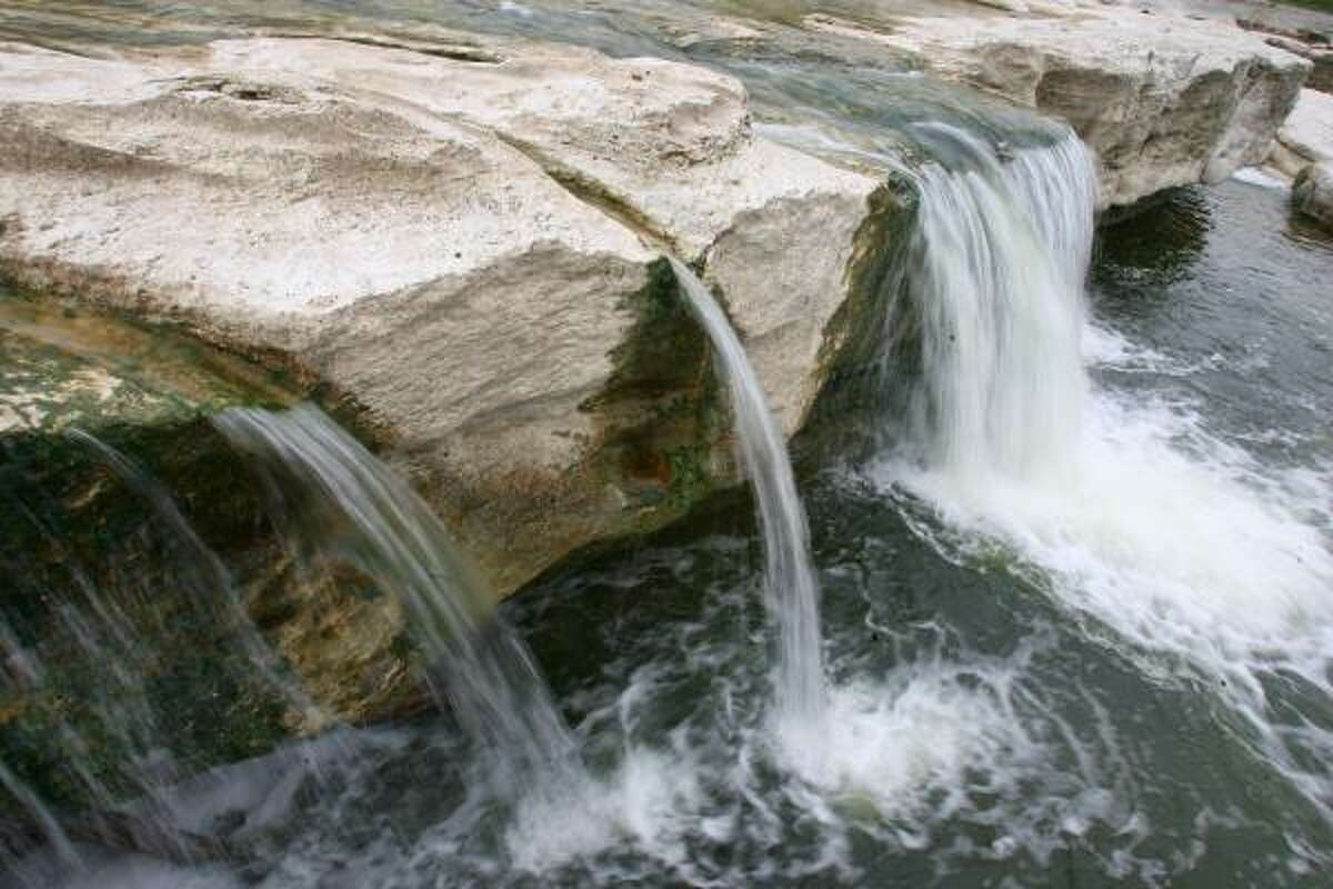 McKinney Falls State Park  Where: Austin  See water from Onion Creek flow off the edge of limestone cliffs at this small state park in the state's capital. Entry fees are $6 per person and free for children 12 and younger.  Source: Texas Parks and Wildlife
