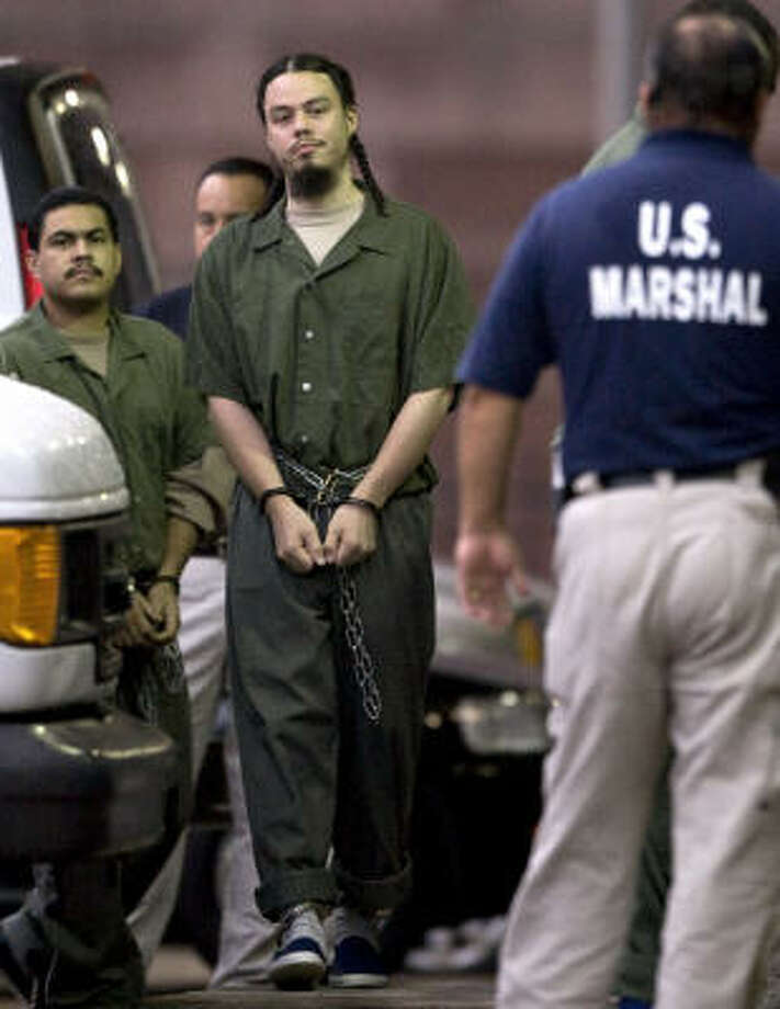 Daniel Joseph Maldonado, center, is escorted into the federal courthouse for his sentencing hearing Friday in Houston. Maldonado pleaded guilty in April to a charge of receiving training from a foreign terrorist organization. Photo: David J Phillip, AP