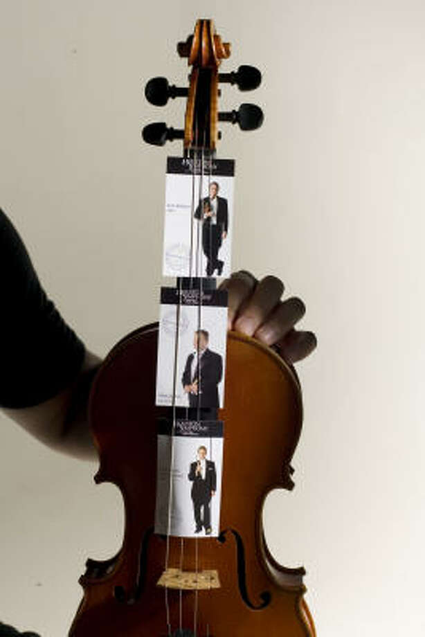 Thirty-three members of the Houston Symphony are featured on trading cards, available to symphony goers during concerts. Photo: Buster Dean, Houston Chronicle