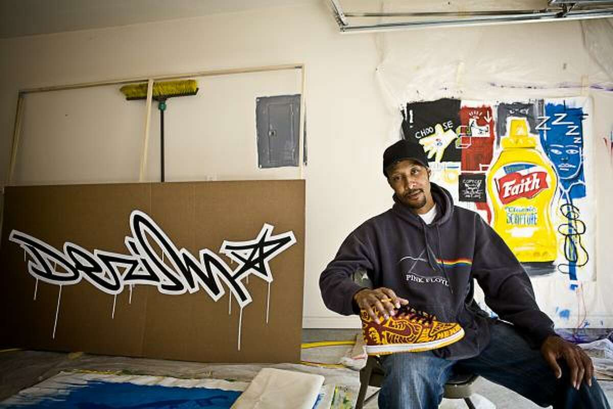 """Desmond """"Dez"""" Woods, a local artist known for his graffiti, airbrushing and sneaker customization and winner of the Mountain Dew Green Label Art contest, works on projects in his home garage, west of Houston."""