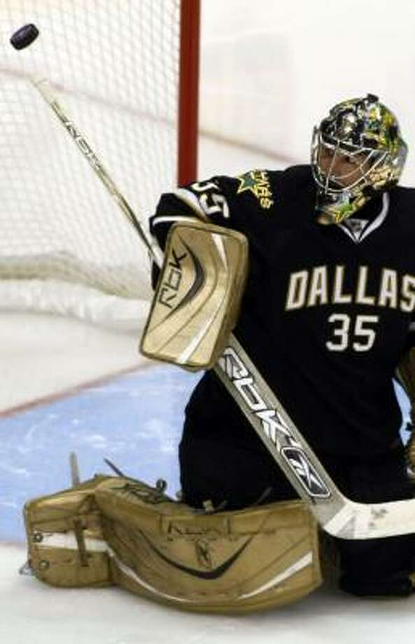 Stars goalie Marty Turco turns aside a shot in the second period Sunday. Photo: SHARON M. STEINMAN, MCT