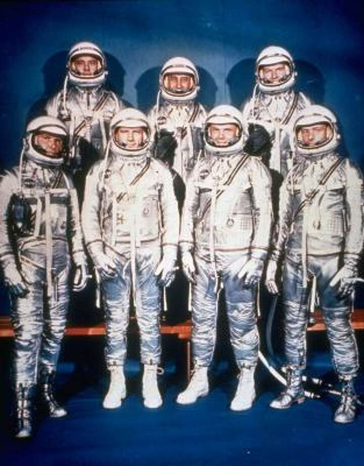 The Mercury 7 astronauts are shown in this 1961 photo provided by NASA. From left are Wally Schirra, Alan Shepard, Deke Slayton, Gus Grissom, John Glenn, Gordon Cooper and Scott Carpenter. Photo: Anonymous, AP