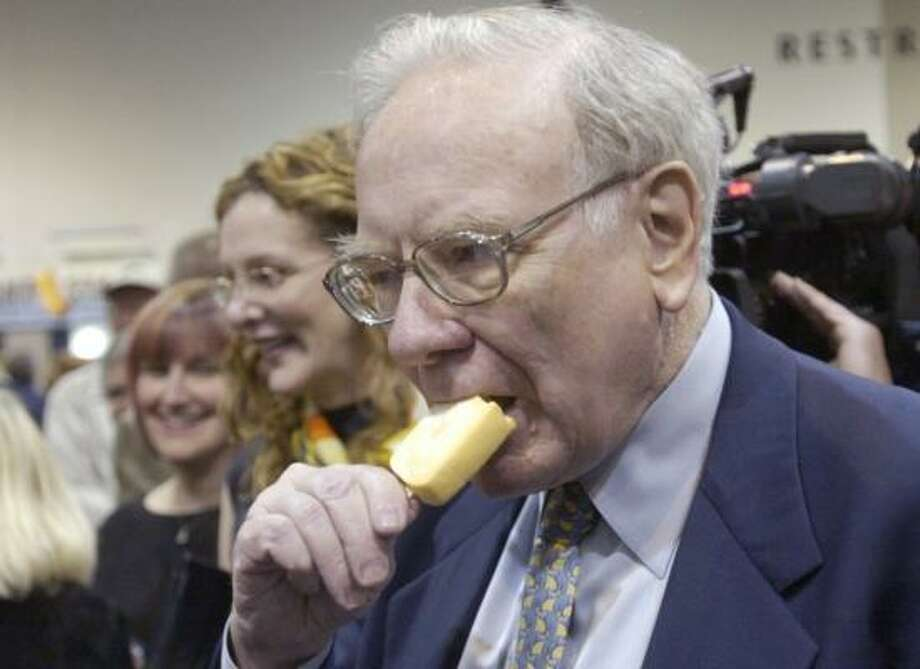 Berkshire Hathaway Chairman Warren Buffett enjoys an ice cream bar at a shareholders meeting in Omaha, Neb. Buffett's investment strategy leans toward well-established products with loyal customer bases. Photo: NATI HARNIK, ASSOCIATED PRESS FILE