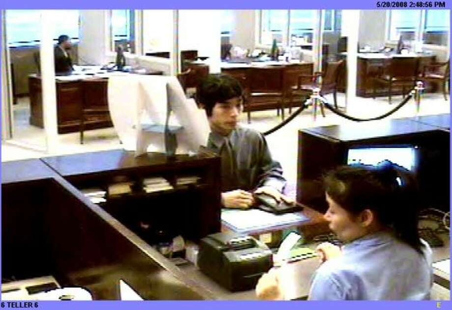 A man who concealed a pistol in a bank bag, and apparently wore a black wig, robbed the Chase Bank at 5847 San Felipe on May 20. Photo: FBI