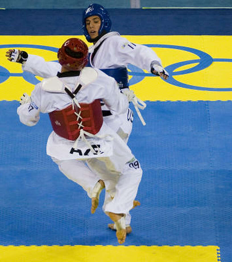 Steven Lopez scores in his bronze-medal fight. Photo: Smiley N. Pool, Chronicle