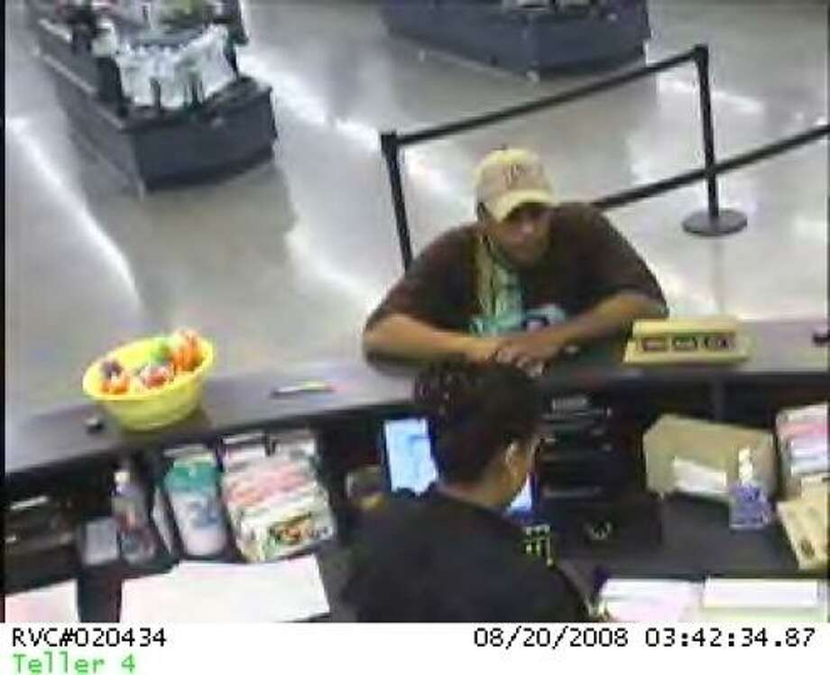 Humble police and the FBI Houston Bank Robbery Task Force have charged Dontel Givens with the Aug. 20 holdup at a bank inside a Wal-Mart store in Humble. Photo: FBI Houston