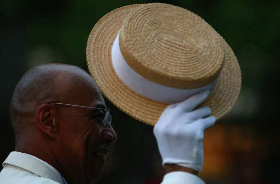Harvey Collar of the Royal Rosarians of Portland tips his hat. Photo: JOSHUA TRUJILLO / SEATTLEPI.COM