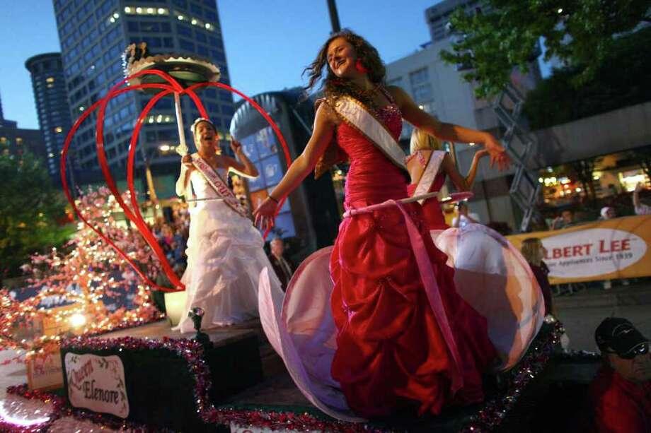 Princess Maycee of the Washington Apple Blossom Festival dances on her float. Photo: JOSHUA TRUJILLO / SEATTLEPI.COM