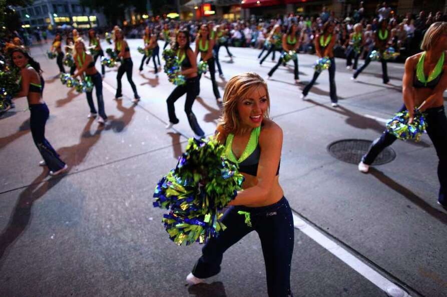 The Seagals perform during the Seafair Torchlight  Parade.