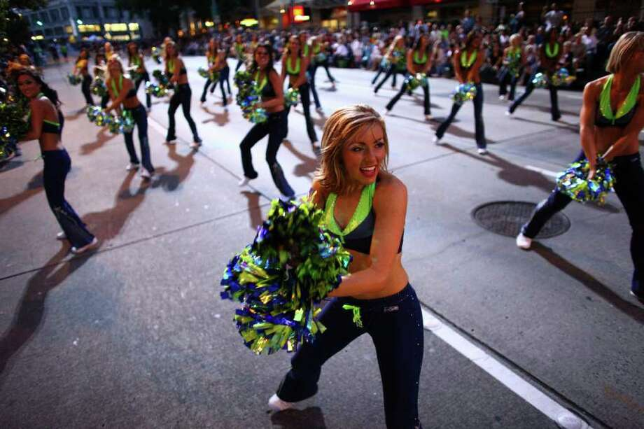 The Seagals perform during the Seafair Torchlight  Parade. Photo: JOSHUA TRUJILLO / SEATTLEPI.COM