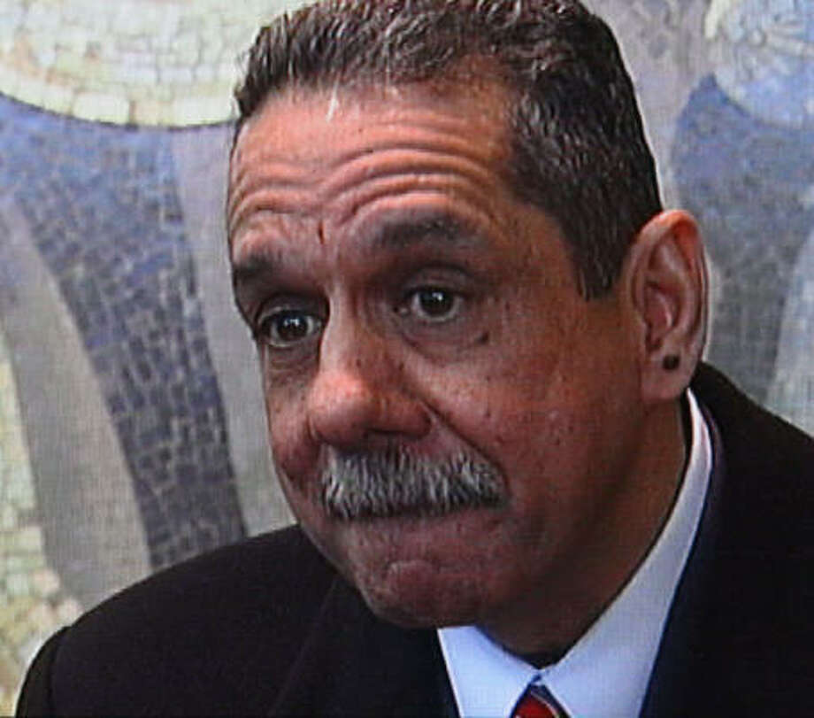 Prosecutors said Carlos Perez-Olivo, shown in New York TV footage, shot his wife, Peggy, for life insurance money totaling $900,000. Photo: WNBC-TV