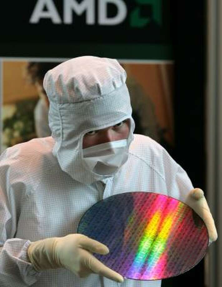 A technician works at AMD's Dresden, Germany, plant. The chip maker is spinning off its factories in Germany. Photo: MATTHIAS RIETSCHEL, ASSOCIATED PRESS FILE
