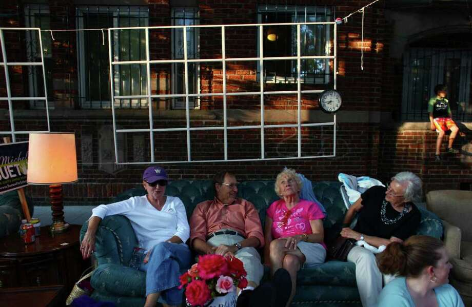Spectators watch the parade from a couch. Photo: JOSHUA TRUJILLO / SEATTLEPI.COM
