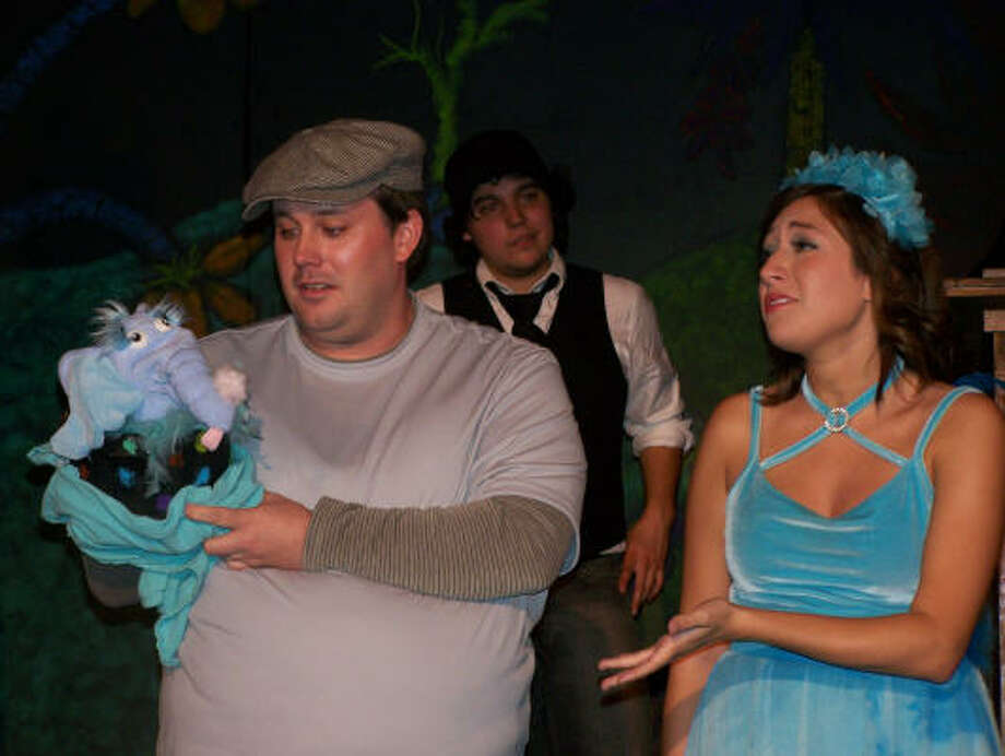 PLAYING THE PART: Jason Howard, as Horton the Elephant, John Morales, playing one of the Wickersham Brothers, and Jillian Silva, portraying Gertrude, rehearse for Baytown Little Theater's upcoming production Seussical the Musical.
