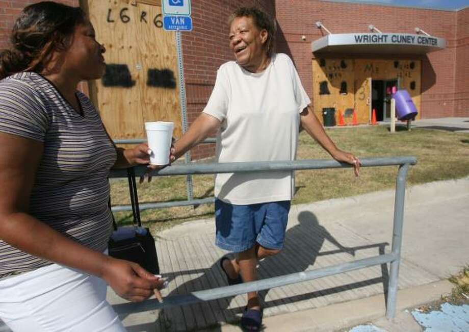 Tracy Breaux, 34, and Esther Deal, 65, chat outside the Wright Cuney Center after casting their votes at one of nine voting sites Tuesday in Galveston. Photo: MAYRA BELTRÁN, CHRONICLE