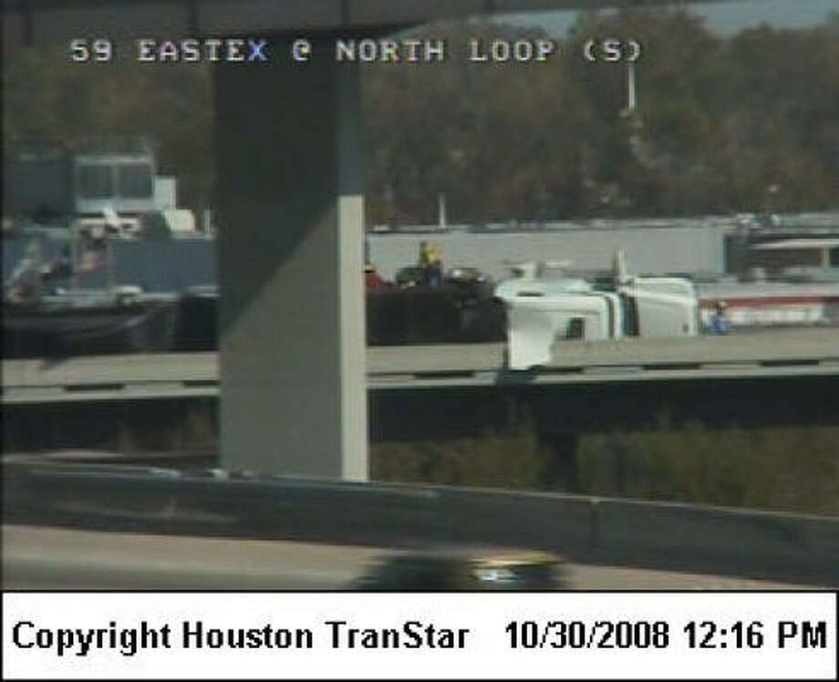 Crews are working to upright the 18-wheeler on a U.S. 59 ramp at Loop 610 North. Photo: Houston TranStar