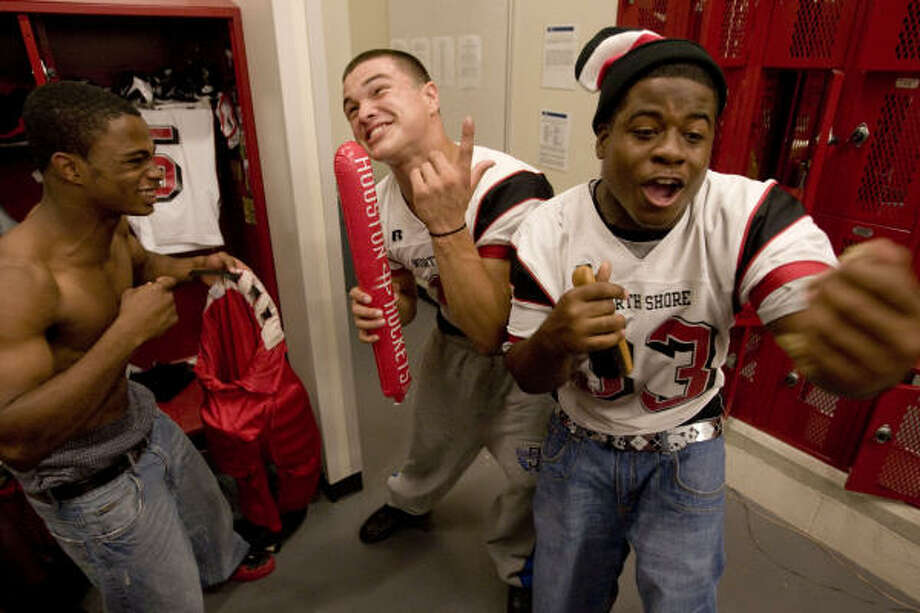 North Shore High school teammates Deaundre Jones, from left, Daniel Salinas and Deon Brouussard sing rap songs as part of their pre-game ritual. Photo: Billy Smith II, Chronicle