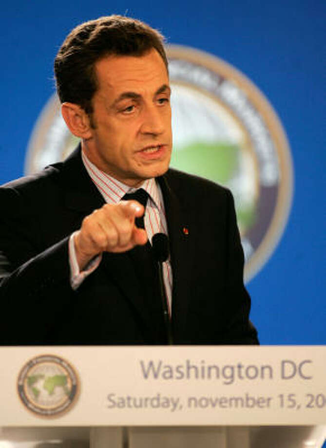 French President Nicolas Sarkozy addresses the media at the end of the Summit on Financial Markets and the World Economy in Washington, Saturday. Photo: Michel Euler, AP