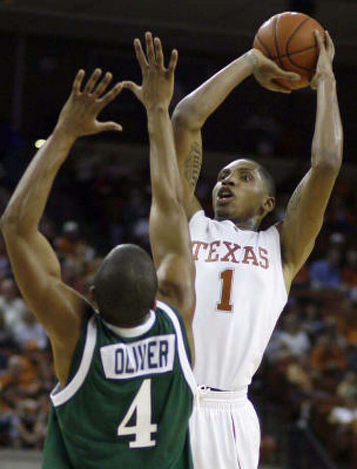 Gary Johnson, right, is rising to the occasion when he leaves the Texas bench and enters the game. Photo: Harry Cabluck, AP