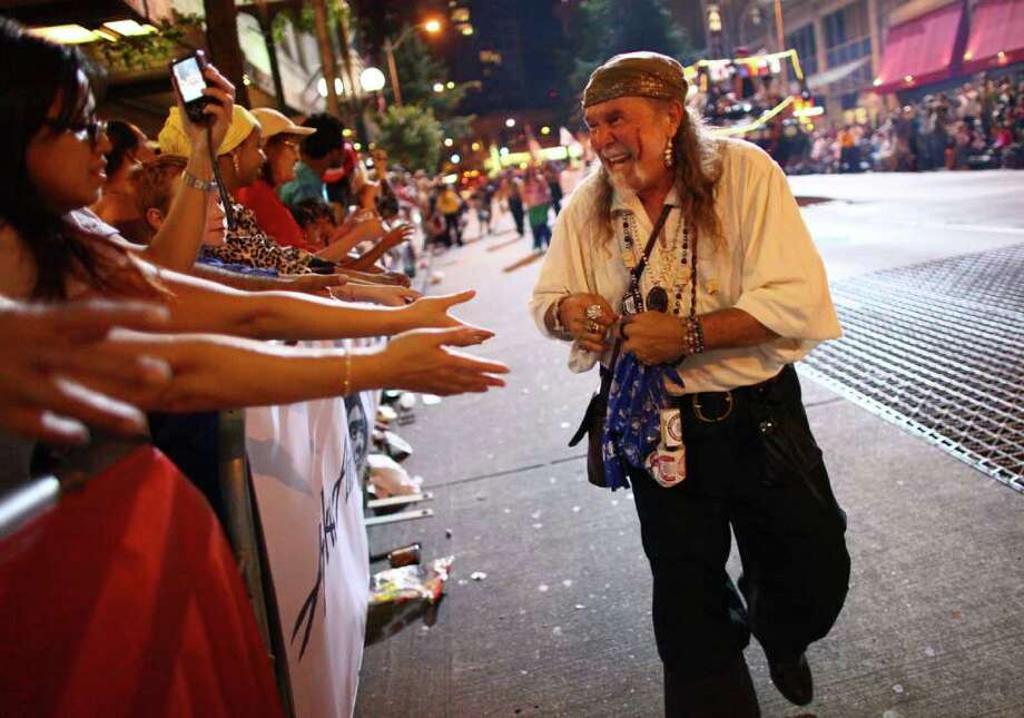 A Seafair Pirate passes out stickers. Photo: JOSHUA TRUJILLO / SEATTLEPI.COM