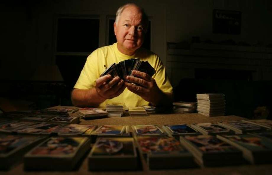 Duffy Burnett and his wife donate enough sports cards to Goodfellows to make even the most dedicated collector envious. Photo: SHARÓN STEINMANN, CHRONICLE