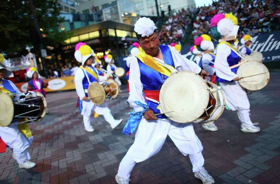 Drummers perform during the Seafair Torchlight  Parade.