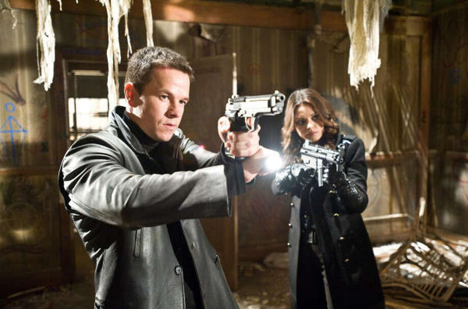 Max Payne (Mark Wahlberg) and Mona Sax (Mila Kunis) team up to battle powerful and dark forces. Photo: Michael Gibson
