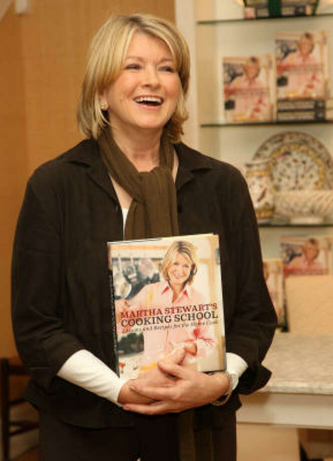 "Kitchen guru Martha Stewart takes a break during a recent signing of her new book in New York. The book, ""Martha Stewart's Cooking School: Lessons and Recipes for the Home Cook,"" focuses on the basics of cooking. Photo: STEPHEN LOVEKIN:, GETTY IMAGES"