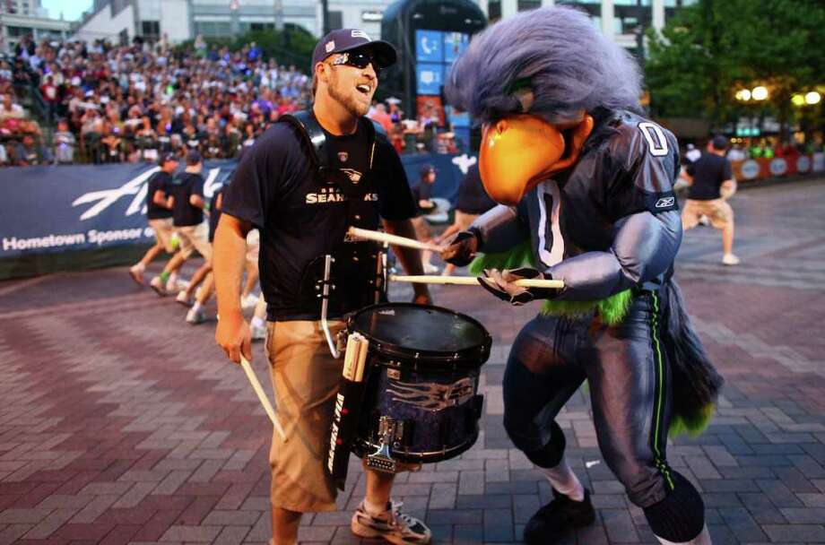 Seattle Seahawk mascot Blitz plays a drum. Photo: JOSHUA TRUJILLO / SEATTLEPI.COM