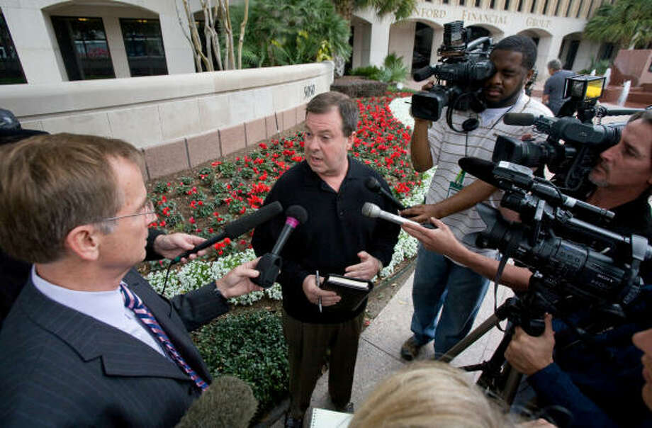 "Kelly DeHay, an investor with Stanford Financial Group, talks to reporters. ""I feel betrayed. I'm not angry, just very betrayed,"" he said. Photo: Steve Campbell, Houston Chronicle"
