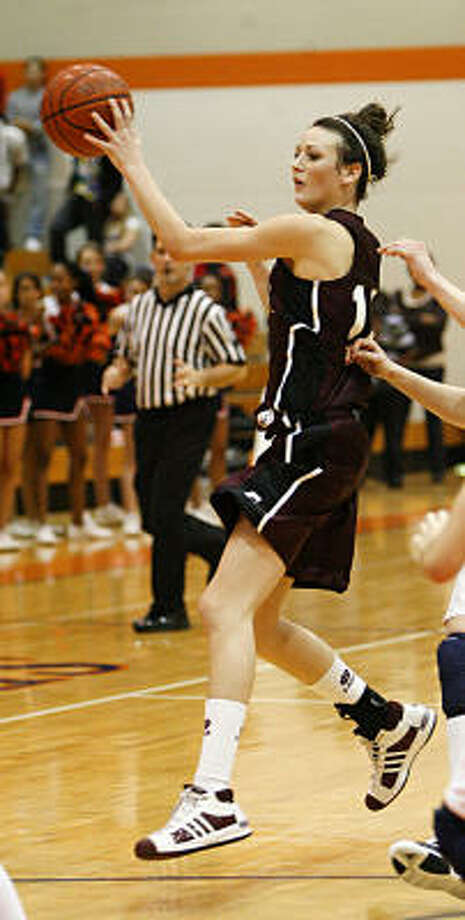 Cinco Ranch guard Demi Clinch scored a career-high 32 points in a win that clinched the division. Photo: Diana L. Porter, For The Chronicle
