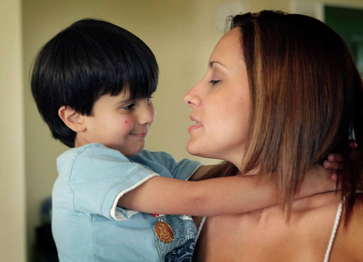 Nathan Bonano gives his mother Brenda Bonano, a hug.