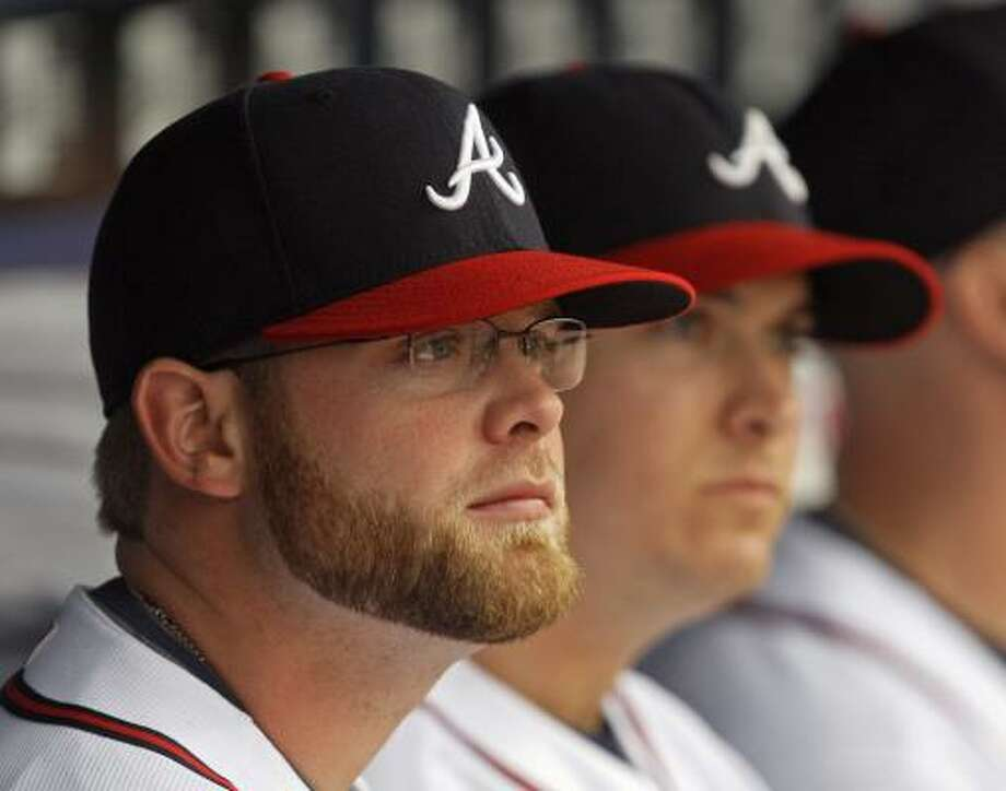 Atlanta Braves catcher Brian McCann wears his new glasses as he sits on the bench before a game.  McCann is hoping the glasses will correct a vision problem that has kept him out of the lineup. Photo: John Bazemore, AP