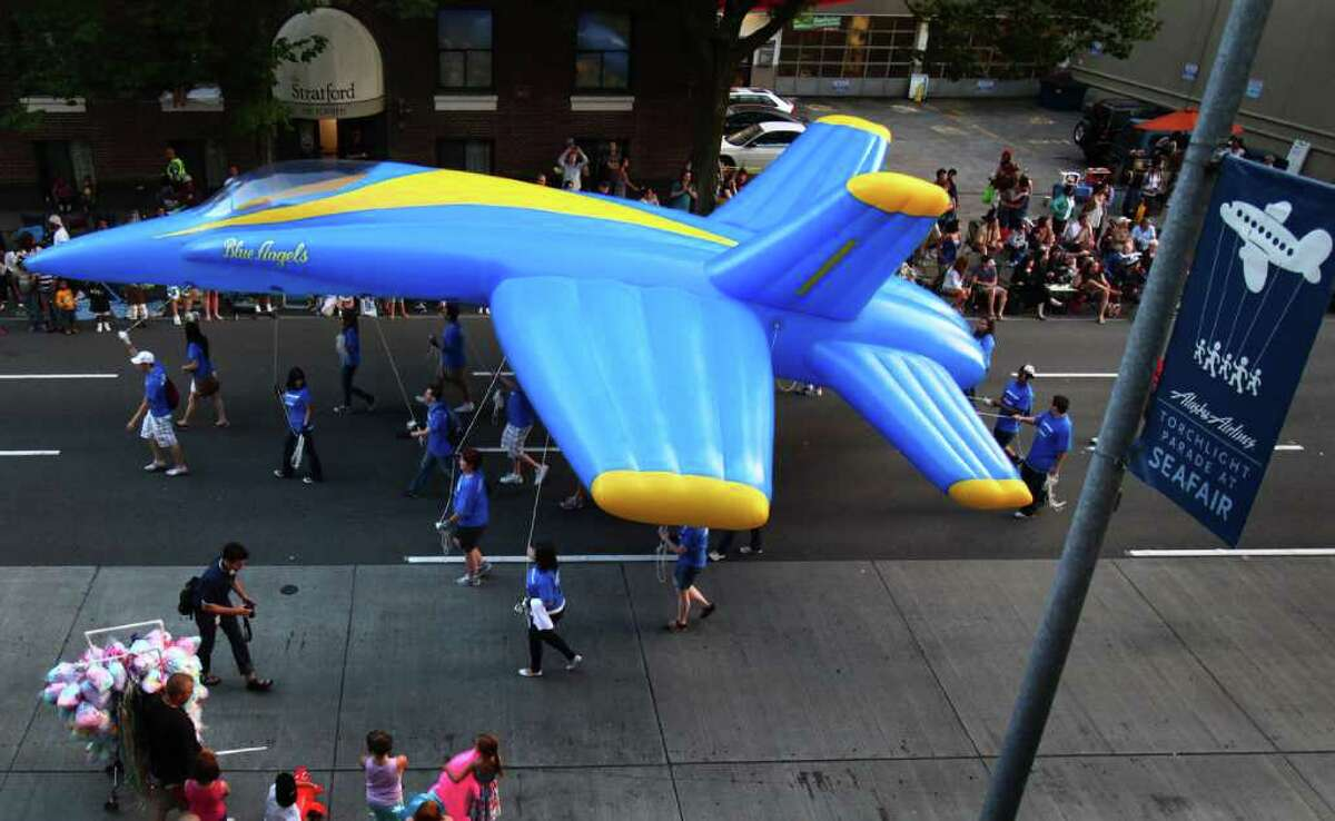 A inflatable Blue Angels airplane floats along the route during the Seafair Torchlight Parade on Saturday, July 30, 2011 in Seattle. The parade featured 106 entries and drew tens of thousands of spectators to downtown Seattle.