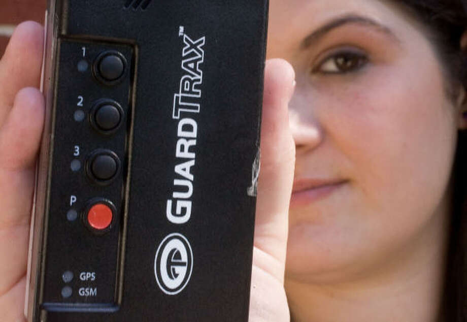 New Caney High school student Clarissa Curry, 17, has to carry this GPS device with her at all times. She's in the truancy program for defying a court order to go to school. Photo: Billy Smith II