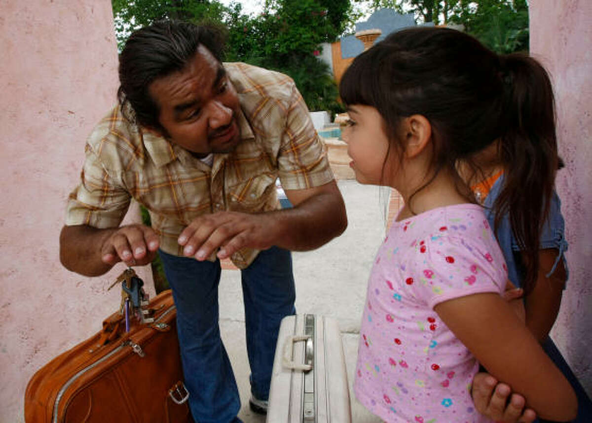 Director Baldemar Rodriguez talks with 8-year-old actress Kayla Valadez during a day of filming.