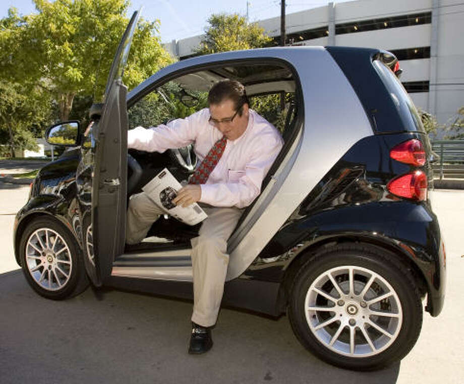 There are three models of the Smart Car, about $12,500 to $17,300. They get 40 to 45 miles per gallon. Photo: Jay Janner, Austin American-Statesman