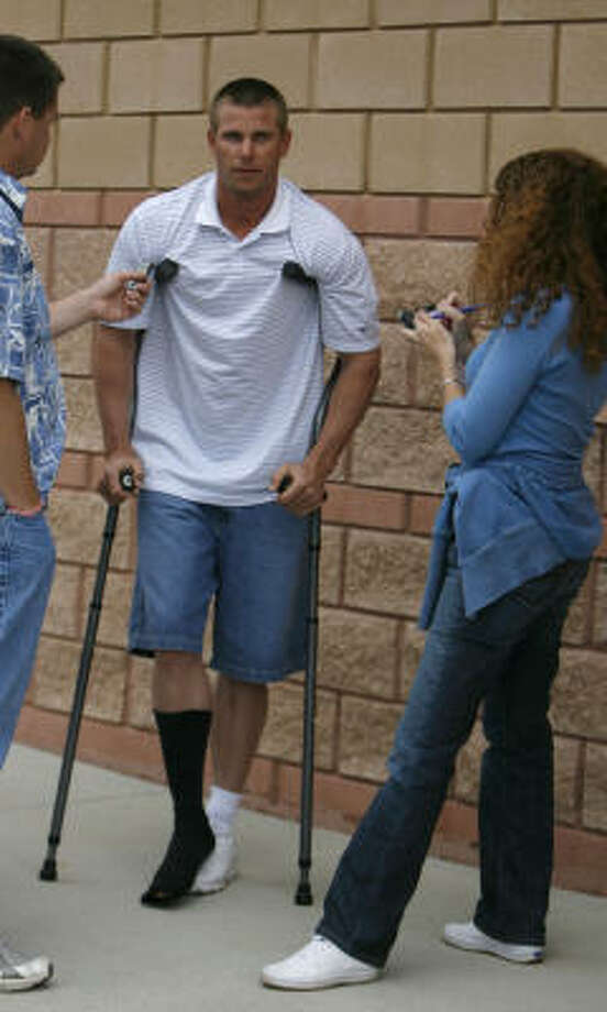 Astros pitcher Brandon Backe leans on crutches Sunday in Kissimmee, Fla. Backe suffered a bone bruise in the right foot when he was hit by a batted ball while throwing live batting practice Saturday. Photo: Karen Warren, Chronicle
