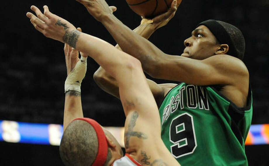 Celtics guard Rajon Rondo (9) goes up strong as the Hawks' Mike Bibby defends in the first half. Photo: Gregory Smith, AP