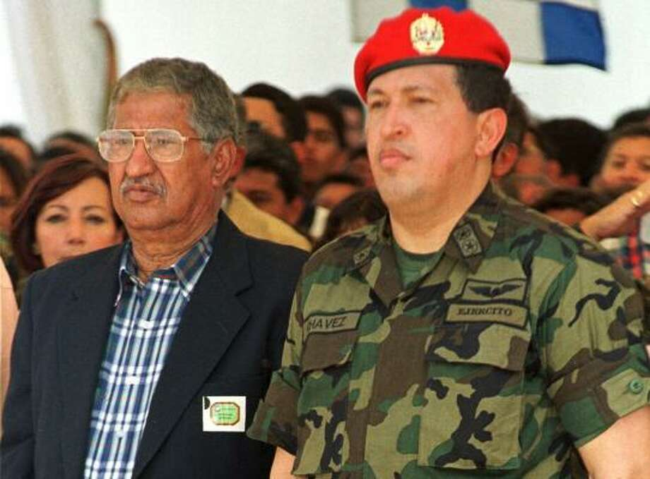 Hugo de los Reyes Chavez, left, with his son, President Hugo Chavez in 1999, will soon retire a rich man after serving as governor of the state of Barinas for 10 years. Photo: ANDRES LEIGHTON, ASSOCIATED PRESS FILE