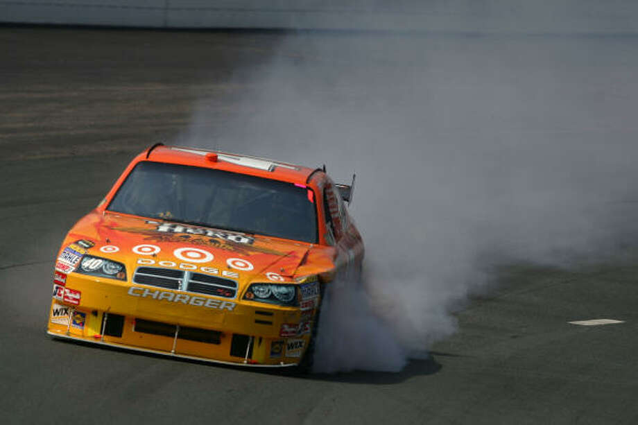 Dario Franchitti, driver of the #40 Guitar Hero/Target Dodge, drives after being damaged during the NASCAR Sprint Cup Series LENOX Industrial Tools 301. Photo: Todd Warshaw, Getty Images For NASCAR