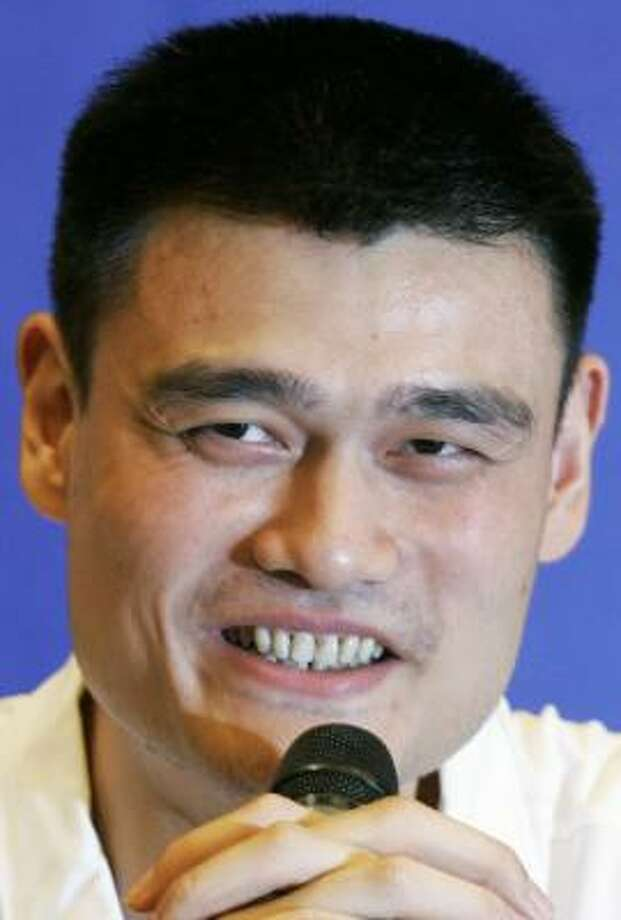 Rockets center Yao Ming will be raffling off a trip to the Beijing Olympics to benefit earthquake victims. Photo: ROBERT F. BUKATY, AP