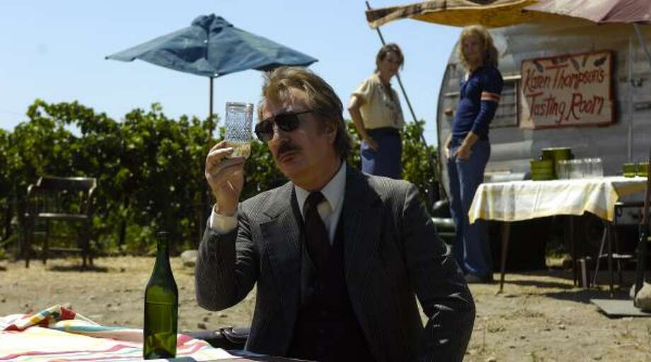 Steven Spurrier (Alan Rickman) examines a bottle of wine at a tasting in Bottle Shock, a film about the Napa Valley wine industry in the mid-1970s. Photo: UNCLAIMED FREIGHT