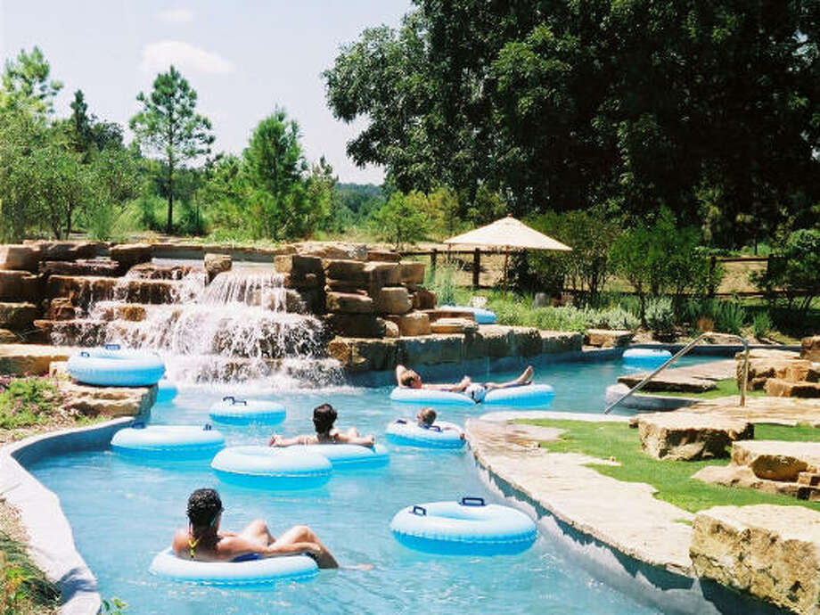 The Crooked River serves as the Hyatt Regency Lost Pines resort's water park. The 1,000-foot river, shaded by pecan and oak trees, includes pools, waterfalls, a water slide and sandy beaches. Photo: Melissa Aguilar, Chronicle