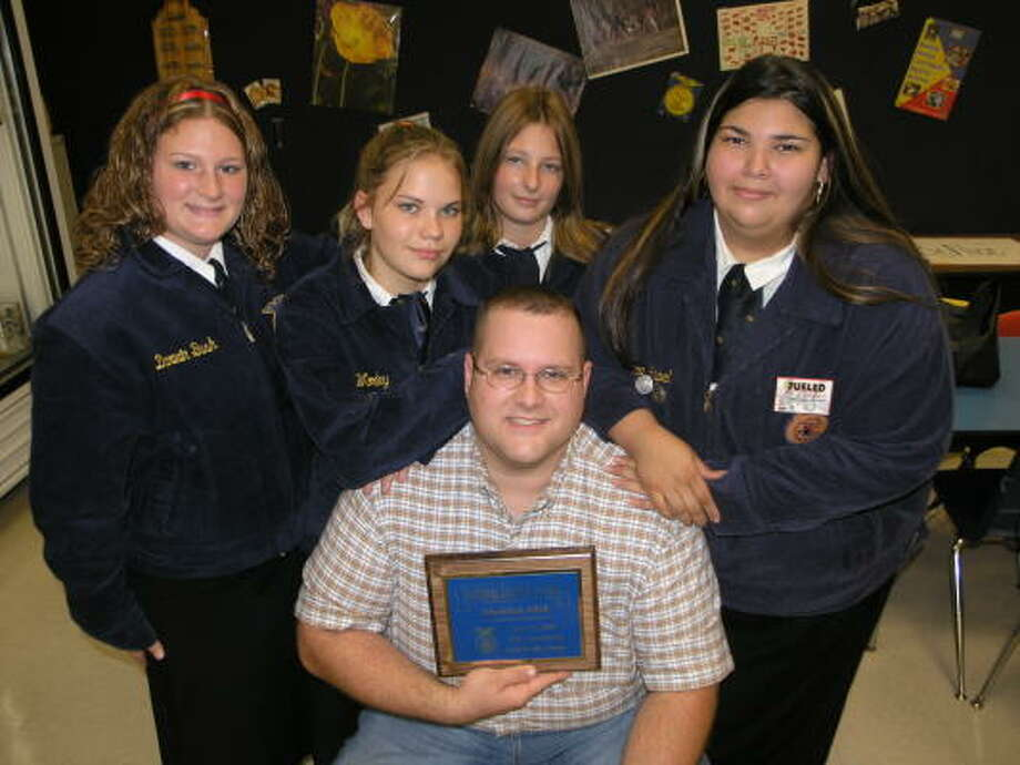 The Sheldon ISD Future Farmer's of America chapter at C.E.King High School is heading to Indianapolis next month to compete for national honors. Members making the trip include, from left,  Brittany Garner, Kaitlyn Worley, Kayla Frank and Veronica Appel. Seated in the front and displaying the award is sponsor Ryan Saucier. Photo: Fannie Williams, For The Chronicle
